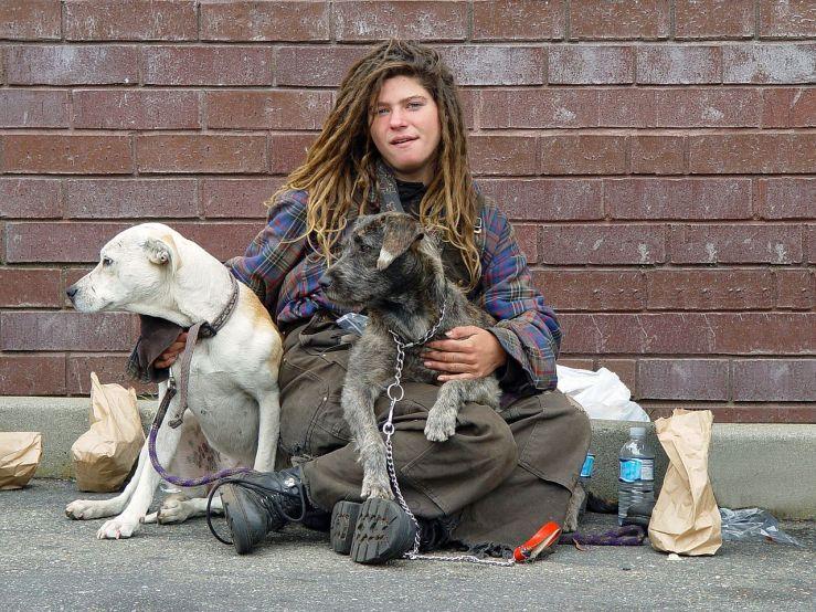 1280px-Homeless_woman