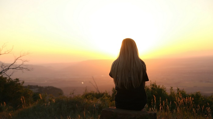 girl gazing at sunset