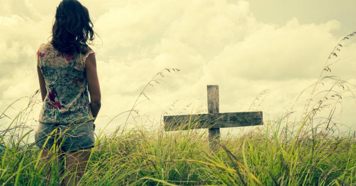Woman and Cross in a Field.jpg