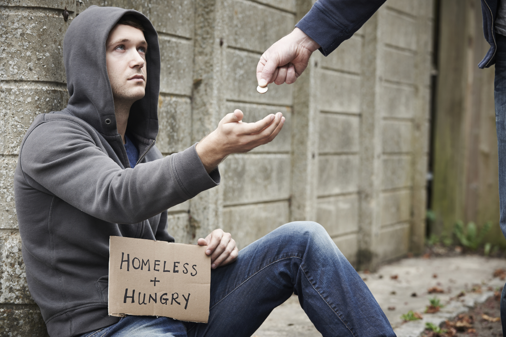 Man Giving Money To Beggar On Street
