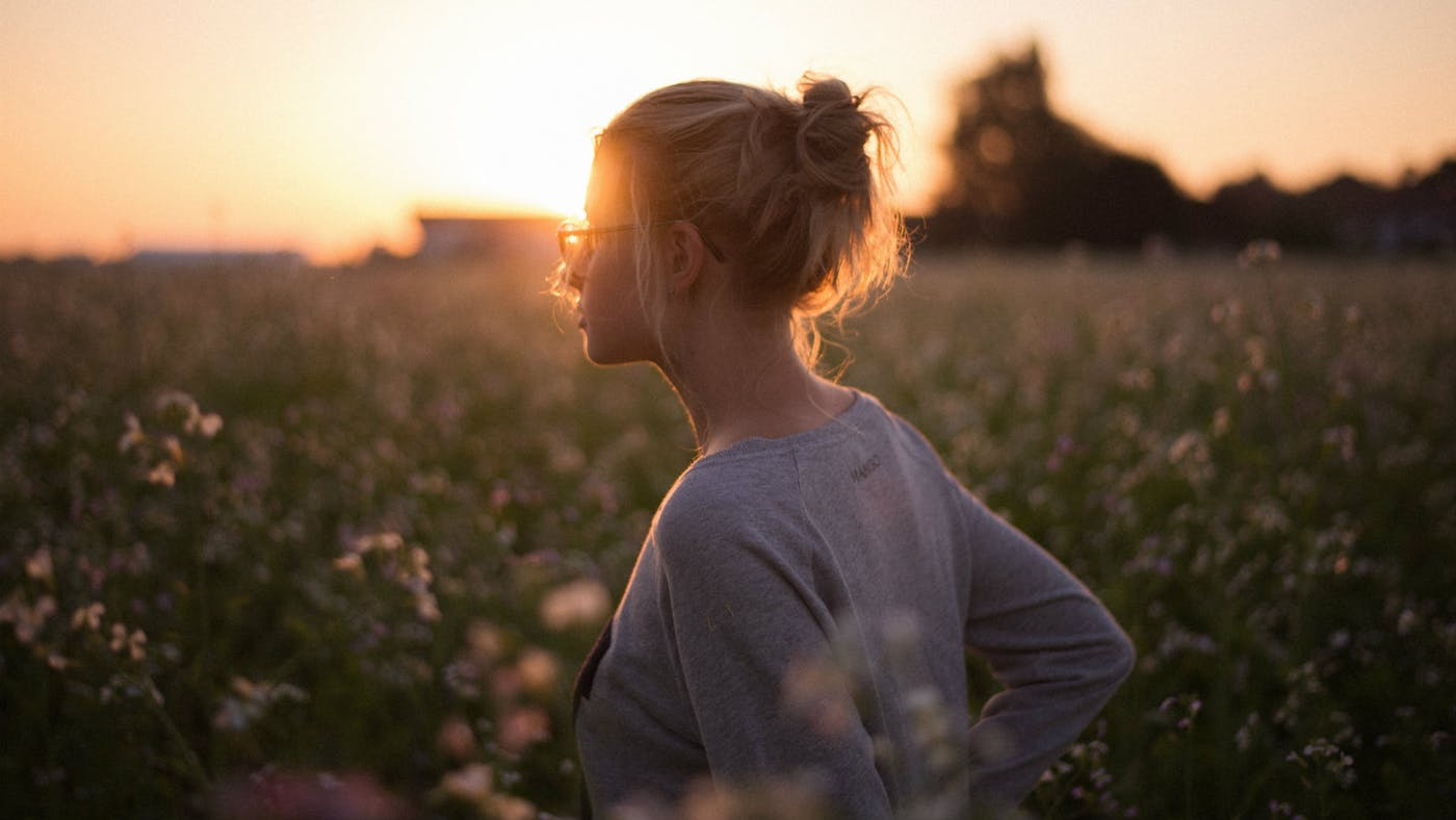 Girl in Meadow Sunset Contemplating